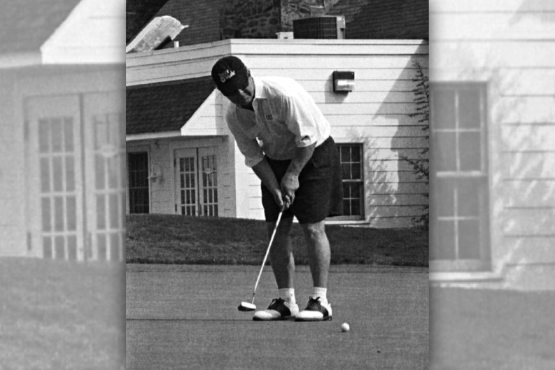 "From the 2003 fifteenth annual Golf Classic souvenir program book, this photo's caption reads ""Steve Kracjes showing it all comes down to the putt."""